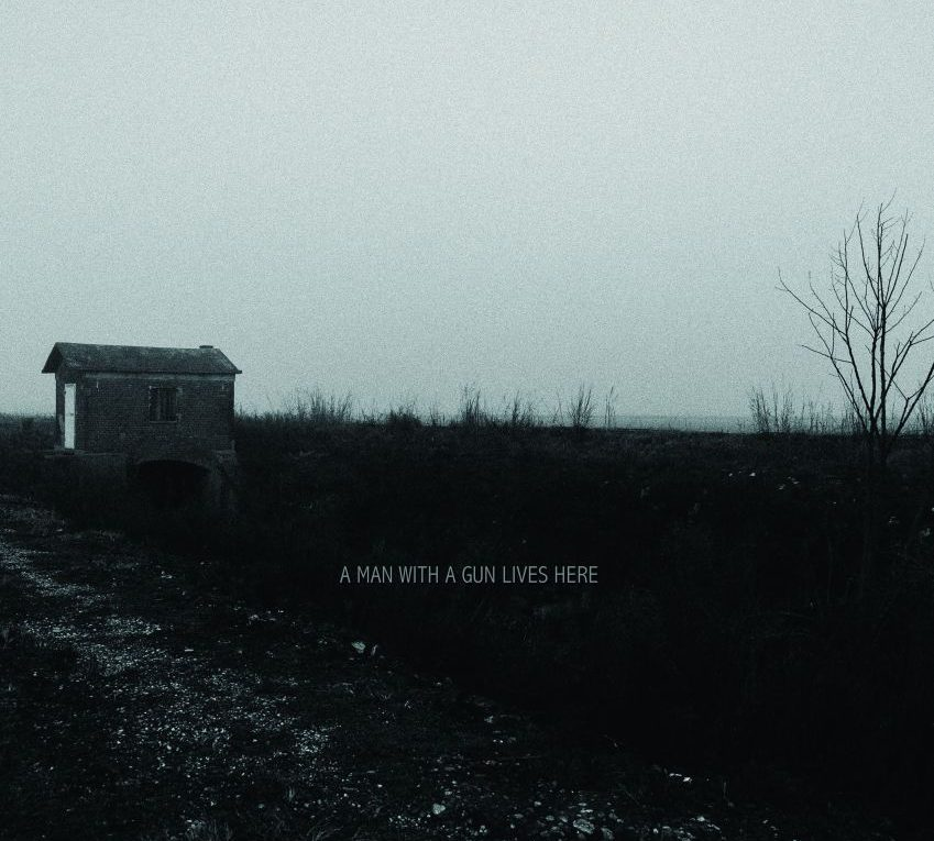 Cover di A Man With A Gun Lives Here